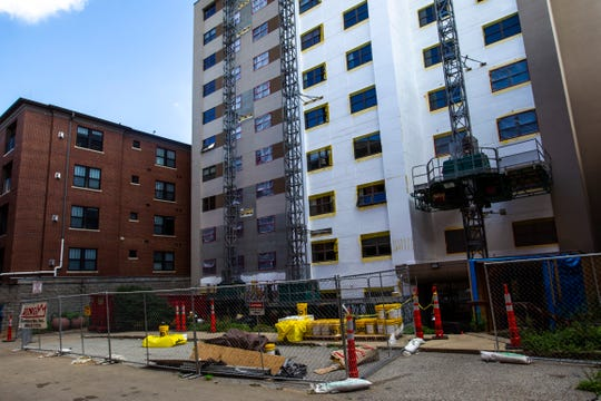 Construction continues on the north side of the Ecumenical Towers, Wednesday, Sept. 4, 2019, in downtown Iowa City, Iowa.