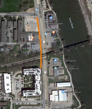 Iowa City engineering department is looking to extend the sidewalk on the west side of S Riverside Drive from its intersection with Myrtle Avenue, through an Iowa Interstate Railroad embankment and to join the sidewalk just south of the embankment.