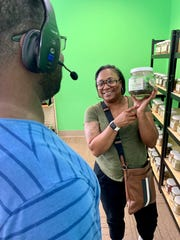 LaVal Williams of Jackson shows her husband, Twain Williams, that dried nettle is available at Rainbow Co-op at Northpark.