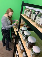 Erin Winstead of Terry stocks up on a variety of herbs and spices at Rainbow Co-op at Northpark in Ridgeland.