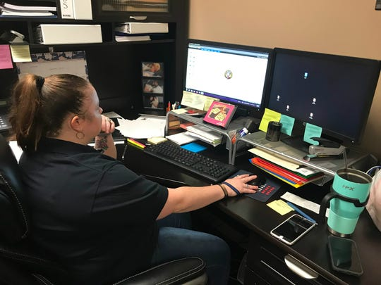 Jackson Police Department Intelligence Analyst Sarah Webb Jones sits ready at her computer in her office Sept. 4, 2019.