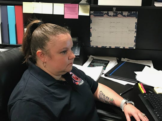 Jackson Police Department Intelligence Analyst Sarah Webb Jones looks at her computer screens in her office Sept. 4, 2019.