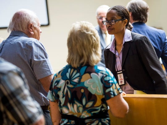 Knox County Assistant District Attorney TaKisha Fitzgerald, right, speaks with Hugh and Mary Newsom, parents of Christopher Newsom, after a hearing about a plea deal for George Thomas in Knox County Criminal Court on Wednesday, Sept., 4, 2019.