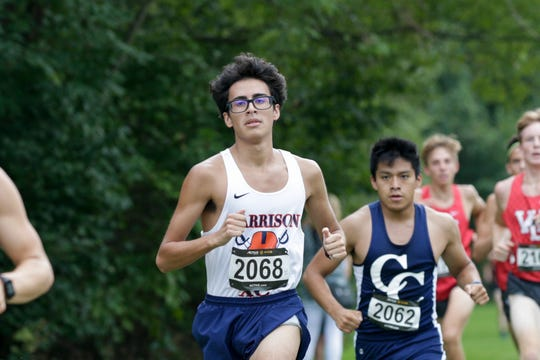 Harrison's Alex Alba (2068) runs during the City/County cross country meet, Tuesday, Sept. 3, 2019 at the Tippecanoe County Amphitheater Park in West Lafayette. The race was canceled half-way through the boys race.