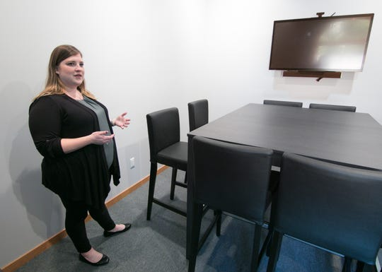 Grit & Lavendar owner Natalie Miller talks Wednesday, Sept. 4, 2019 about how groups might use facilities like this conference room, one of two in the newly opened Brighton co-working office space.