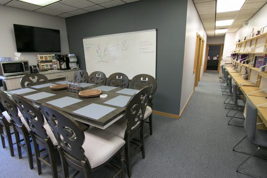A dining area and collaborative desk spaces in a common area of Grit & Lavender in Brighton, shown Wednesday, Sept. 4, 2019, are among the various work spaces at the newly opened co-working space.