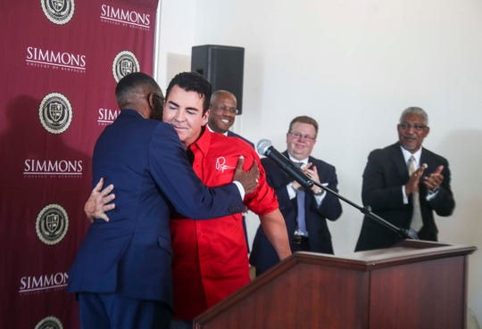 Papa John's founder John Schnatter hugs Rev. Kevin Cosby at Simmons College of Kentucky before speaking Wednesday afternoon at the private black college. Schnatter donated $1 million to the school. Schnatter's public appearance at Simmons on Wednesday was one the first since he was forced from the Papa John's chairmanship and evicted from the company's East Louisville headquarters after reports in July 2018 that he'd used a racial slur during a media training session.