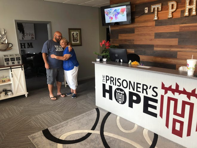Michael Bennett and his mother, Carol Fincher, at The Prisoners Hope ministry office after his release from prison.