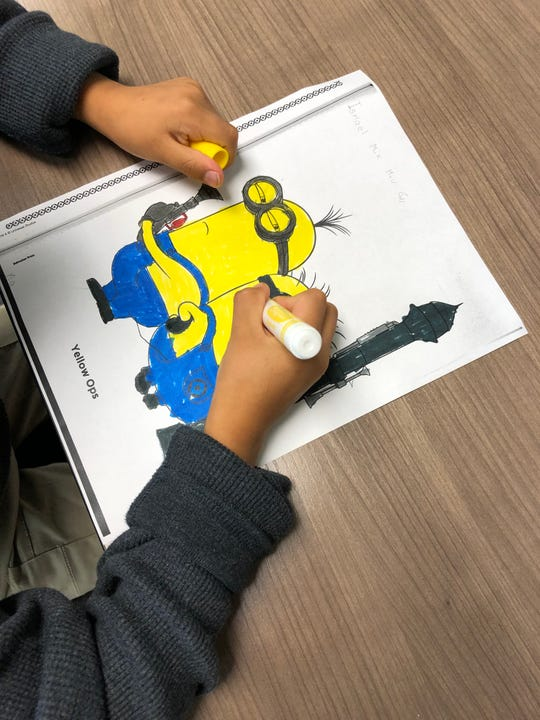 A refugee child in a foster care home in the Lansing area works on coloring a picture in this undated photo. Bethany Christian Services and Samaritas are searching for new foster parents to help refugee children.