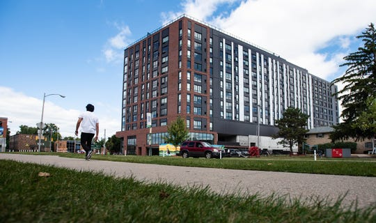 The Hub on Campus apartments in downtown East Lansing at the corner of Bogue Street and Grand River Avenue.