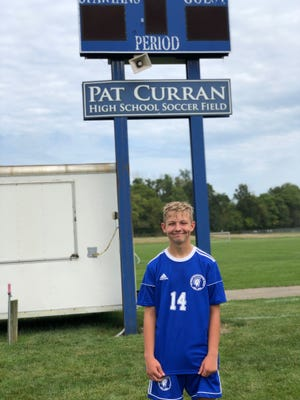 St. Peter's freshman Sean Putt has overcome serious health issues to play for the Spartans on the home field named after his late grandfather, Pat Curran. Putt scored a goal in his first varsity home game last Saturday.