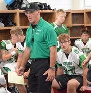 Clear Fork coach Dave Carroll, who has led his alma mater to back-to-back 10-0 regular seasons, addresses the Colts in the locker room at Fredericktown last Friday.