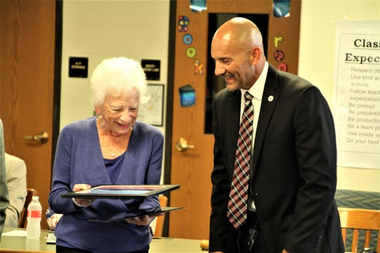 "Mary Ellen Withrow, left, and Marion City Schools Superintendent Ron Iarussi share a laugh during the reception in her honor on Tuesday at Grant Middle School. Iarussi called Withrow ""a rock star"" during the presentation honoring her."