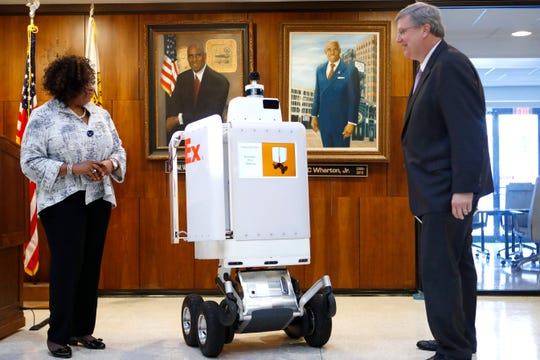 Gloria Boyland, corporate vice president of operations and service support at FedEx, introduces their delivery robot Roxo to Mayor Jim Strickland at City Hall downtown on Wednesday, Sep. 4, 2019.