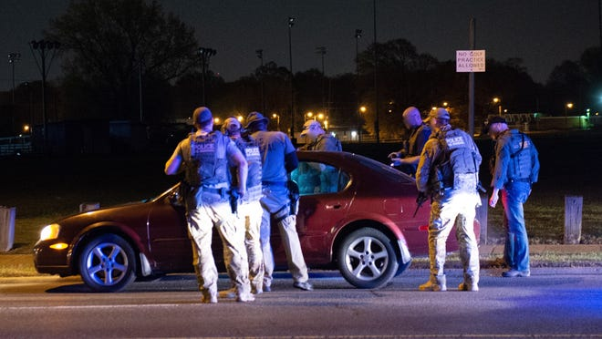 Jahmazeo Richardson, the then 20-year-old driver of this car, was stopped by a task force of U.S. marshals and local law enforcement as he drove home from work April 1, 2015. The U.S. Marshals Service produced photos from the scene, where Richardson was shot at, in the course of a civil trial. Richardson's lawyer, Robert Spence, blurred the faces of the officers.