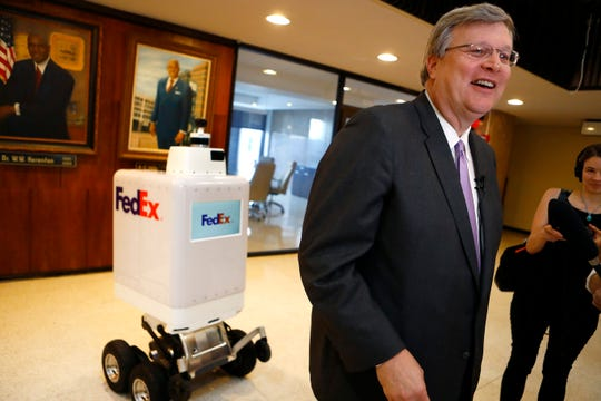 FedEx's delivery robot Roxo is introduced to Mayor Jim Strickland at City Hall downtown on Wednesday, Sep. 4, 2019.