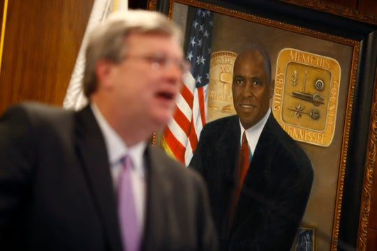 Mayor Jim Strickland speaks at City Hall downtown while a portrait of former mayor Willie Herenton, who is running again for the seat, hangs on the wall in the background on Wednesday, Sep. 4, 2019.