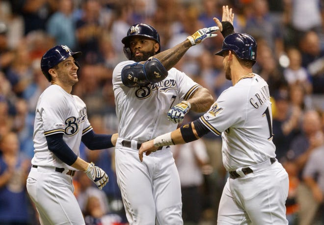 Brewers first baseman Eric Thames (7) celebrates after hitting a three-run home run during the third inning against the Houston Astros at Miller Park.