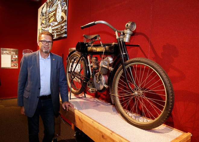"James Kieselburg II, director of the Grohmann Museum on the MSOE campus, looks at The Merkel, a motorcycle that predated the Harley-Davidson machines. The motorcycle is part of an exhibit of local engineering milestones called ""The Magnificent Machines of Milwaukee."""