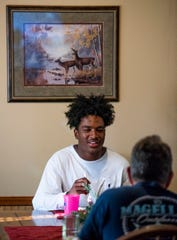 Prattville football player Isaiah Causey chats with his dad Terry Causey as they eat dinner at their home in Prattville, Ala., on Monday September 2, 2019.