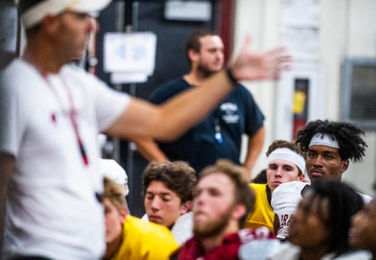 Isaiah Causey, right, looks on as Prattville head coach Caleb Ross holds a team meeting after practice at the school in Prattville, Ala., on Monday August 26, 2019.