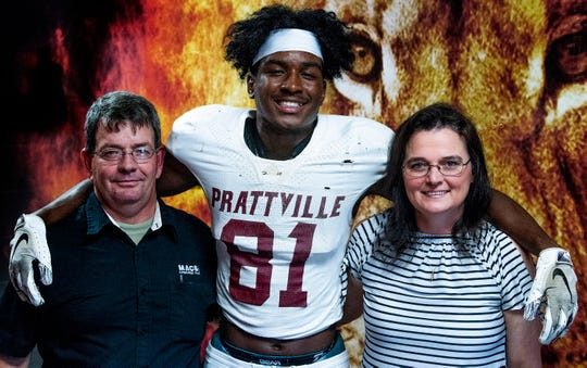 Isaiah Causey poses for a photo with his parents, Terry and Marsha Causey, before football practice at Prattville High School in Prattville, Ala., on Monday August 26, 2019.