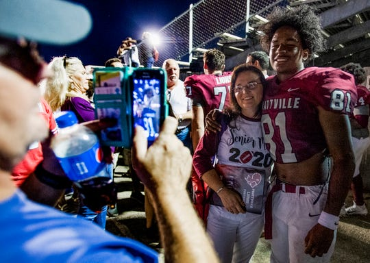 Prattville's Isaiah Causey poses for a photo with his mom Marsha Causey after Prattville defeated Stanhope in Prattville, Ala., on Friday August 30, 2019.