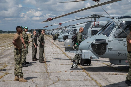 Sailors inspect U.S. Navy MH-60R Sea Hawk helicopters after arriving at Maxwell Air Force Base, Alabama, from Naval Air Station Jacksonville and Naval Station Mayport, Florida, Sept. 1, 2019. The helicopters evacuated from the Jacksonville area in advance of Hurricane Dorian. In addition to the helicopters, Maxwell AFB is serving as an Incident Support Base for Federal Emergency Management Agency and Defense Logistics Agency personnel and equipment.