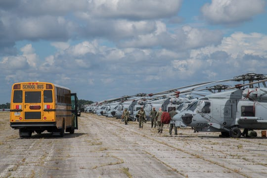 Sailors depart U.S. Navy MH-60R Sea Hawk helicopters after arriving at Maxwell Air Force Base, Alabama, from Naval Air Station Jacksonville and Naval Station Mayport, Florida, Sept. 1, 2019. The helicopters evacuated from the Jacksonville area in advance of Hurricane Dorian. In addition to the helicopters, Maxwell AFB is serving as an Incident Support Base for Federal Emergency Management Agency and Defense Logistics Agency personnel and equipment.