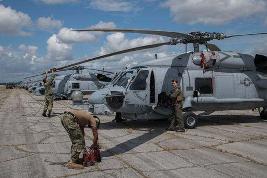 Sailors secure U.S. Navy MH-60R Sea Hawk helicopters after arriving at Maxwell Air Force Base, Alabama, from Naval Air Station Jacksonville and Naval Station Mayport, Florida, Sept. 1, 2019. The helicopters evacuated from the Jacksonville area in advance of Hurricane Dorian. In addition to the helicopters, Maxwell AFB is serving as an Incident Support Base for Federal Emergency Management Agency and Defense Logistics Agency personnel and equipment.