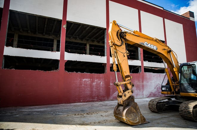 Construction crews continue work on the former Sears site in downtown Muncie in preparation for new owner Accutech Systems.