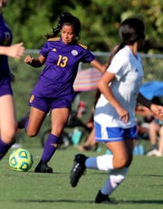 Smyrna's Beca Lopez (13) kicks the ball during the game against La Vergne at Smyrna on Tuesday Sept. 3, 2019.