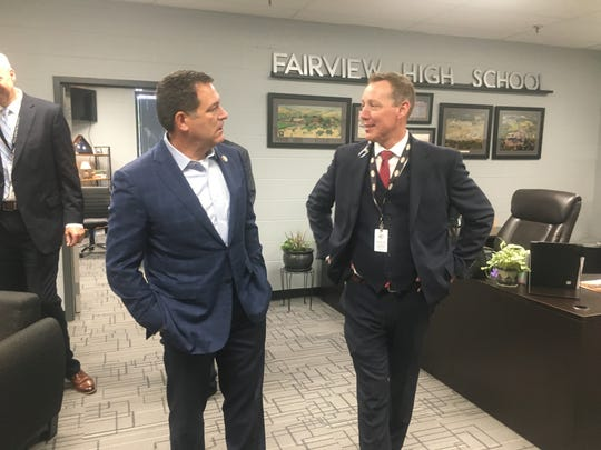 U.S Rep. Mark Green and Fairview High School principal Kurt Jones converse in the school's administration offices.