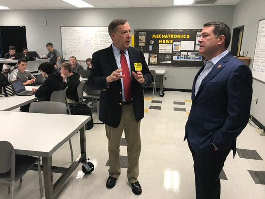 Rep. Sam Whitson, who sponsored legislation offering free tuition for dual college enrollment for mechatronics students at Fairview High, explains the program to U.S. Rep. Mark Green during a recent tour.
