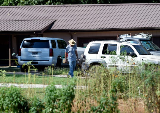 Wayne Clinard walks in front of the house where five members of a family were slain after talking with law enforcement on Wednesday, Sept. 4, 2019, in Elkmont, Ala. Clinard rented the house to the family. A 14-year-old boy called 911 Monday night and later admitted to authorities he killed his parents and three younger siblings, including a 6-month-old baby, in Elkmont, near the Alabama-Tennessee border.