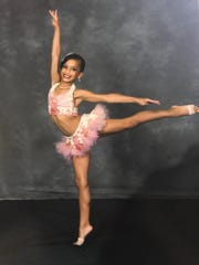 A studio picture of Mariah Russell when she was 8 or 9 years old