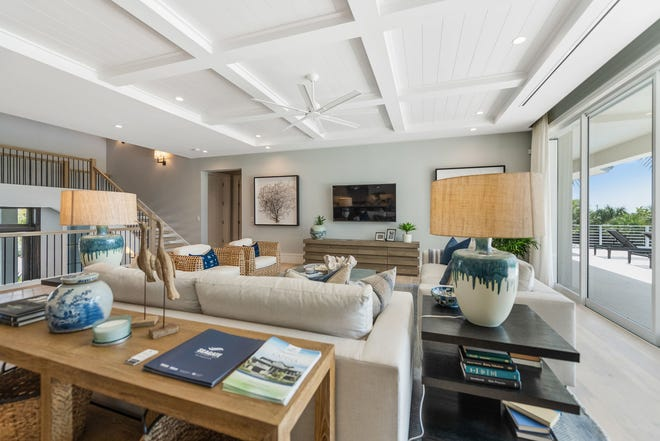 The Captiva model (shown) at Hill Tide Estates and Cayman II model at Windward Isle feature interiors by Theory Design's Vice President of Design Ruta Menaghlazi.