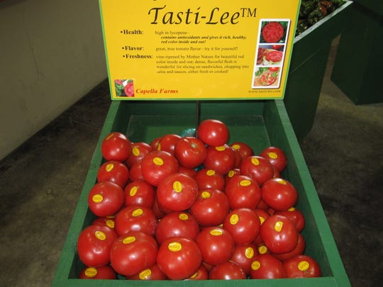 Display of branded Tasti-Lee tomatoes being sold at a Whole Foods supermarket.  2009 Annual Research Report file photo.