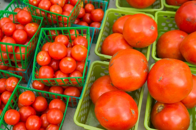 Locally grown tomatoes at a farmers market.
