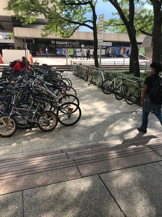 The existing bike racks at Journal Square PATH station in Jersey City are packed, and susceptible to theft or damage.