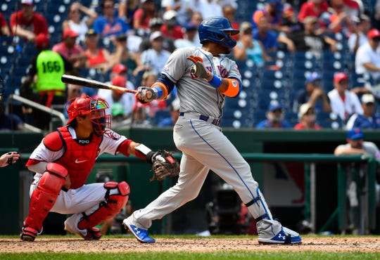 Sep 4, 2019; Washington, DC, USA; New York Mets second baseman Robinson Cano hits a two run home run against the Washington Nationals during the fourth inning at Nationals Park. Mandatory Credit: Brad Mills-USA TODAY Sports