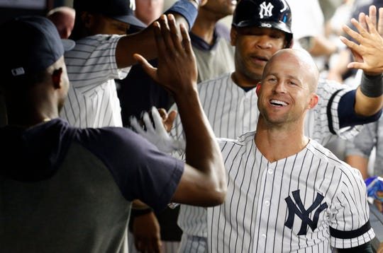 Sep 3, 2019; Bronx, NY, USA; New York Yankees left fielder Brett Gardner (11) is congratulated after hitting a two run home run against the Texas Rangers during the sixth inning at Yankee Stadium. Mandatory Credit: Andy Marlin-USA TODAY Sports