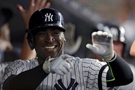 Didi Gregorius #18 of the New York Yankees celebrates in the dugout after hitting a three run home run against the Texas Rangers during the sixth inning at Yankee Stadium on Sept. 3, 2019 in New York City.