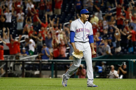 New York Mets relief pitcher Edwin Diaz walks off the field after Washington Nationals' Kurt Suzuki hit a game-winning three-run home run in the ninth inning of a baseball game Tuesday, Sept. 3, 2019, in Washington. Washington won 11-10.