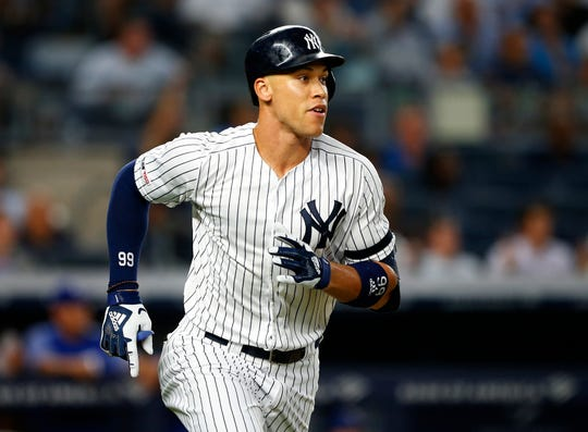 Sep 4, 2019; Bronx, NY, USA;  New York Yankees right fielder Aaron Judge (99) rounds the bases after hitting a home run in the third inning against the Texas Rangers at Yankee Stadium. Mandatory Credit: Noah K. Murray-USA TODAY Sports