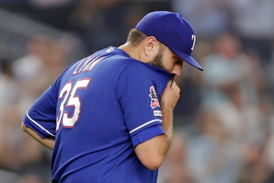 Texas Rangers starting pitcher Lance Lynn reacts after allowing a two-run home run to New York Yankees' Aaron Judge during the third inning of a baseball game Wednesday, Sept. 4, 2019, in New York. (AP Photo/Kathy Willens)