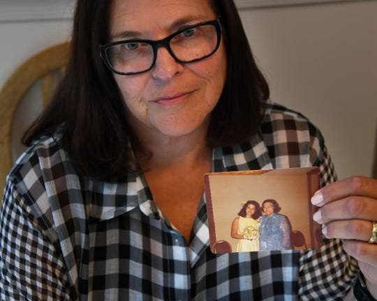 Fern Taylor at her home on Wednesday, September 4, 2019. Taylor holds a photo of herself and her mother taken in 1978. Taylor has familial hypercholesterolemia (FH), which is genetic high cholesterol. Her mother also had FH, she died from heart failure at age 56.