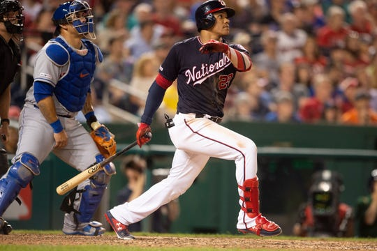 Sep 3, 2019; Washington, DC, USA;  Washington Nationals left fielder Juan Soto (22) hits a two run home run in the eighth inning  against the New York Mets at Nationals Park.