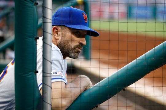 New York Mets manager Mickey Callaway stands in the dugout before the team's baseball game against the Washington Nationals, Tuesday, Sept. 3, 2019, in Washington. (AP Photo/Patrick Semansky)