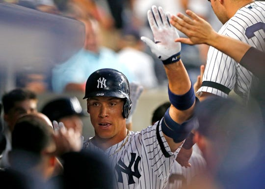 Sep 4, 2019; Bronx, NY, USA;  New York Yankees right fielder Aaron Judge (99) celebrates in the dugout after hitting a home run in the third inning against the Texas Rangers at Yankee Stadium. Mandatory Credit: Noah K. Murray-USA TODAY Sports